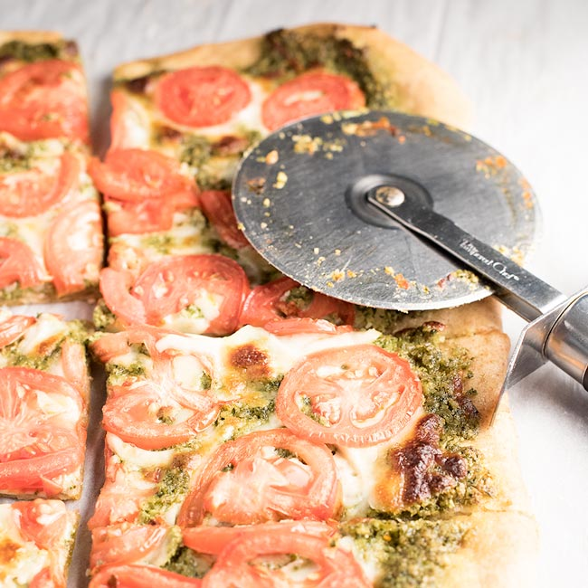Basil Pesto Pizza with Plum Tomatoes..yet another great use for pesto!
